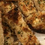 Crispy Garlic Bread after broiled in the oven sliced and ready to eat